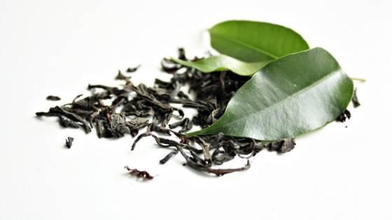 drinking green tea with lemon